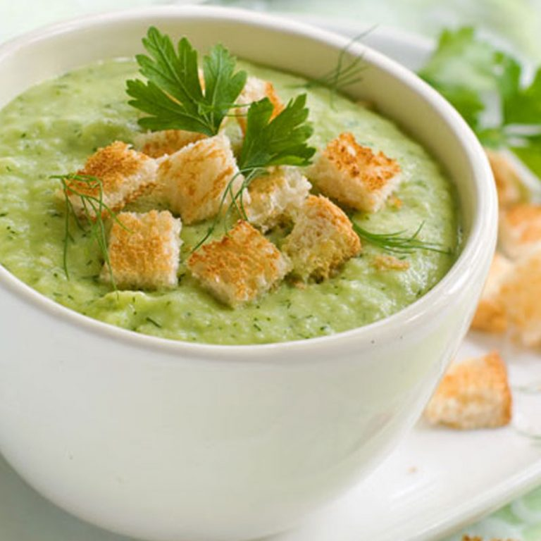 Curried zucchini soup pairs well with a tomato salad and a loaf of crusty bread.