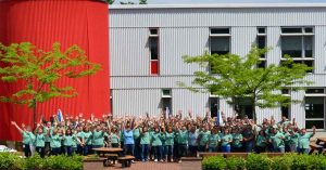 Stonyfield Team Cheering In Front Of Plant