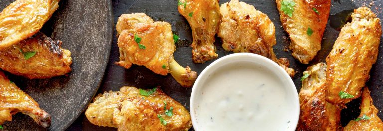 Make yogurt marinated chicken wings with yogurt ranch dressing for your next cookout.
